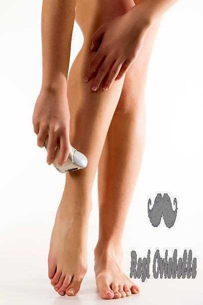 Woman shaving her legs with razor best electric shaver for women
