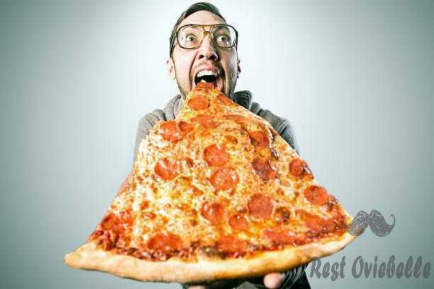 Man Eating Oversized Pizza Slice Why Your Hair Stops Growing?