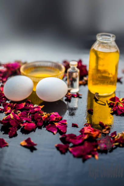 Trio pack of herbs and ingredients to fight dandruff on the wooden surface well mixed in a glass bowl which are castor oil coconut oil and egg. Also used to treat itchiness and to deep condition. Home Remedies For Hair Growth