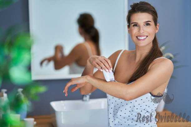 beautiful brunette woman epilating arms in the bathroom - epilator for face and body s and pictures How To Find The Best Epilator For Face And Body