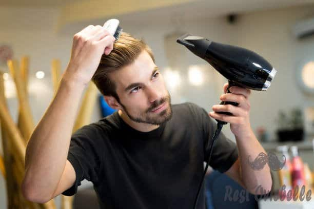 female hairdresser combing and drying his own hair in hair salon - hair dryers for men s and pictures Best Hair Dryers For Men