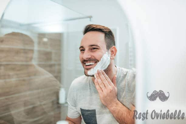 handsome man applying shaving cream reflection in the mirror image. - shave cream s and pictures Things To Consider When Buy Shave Cream