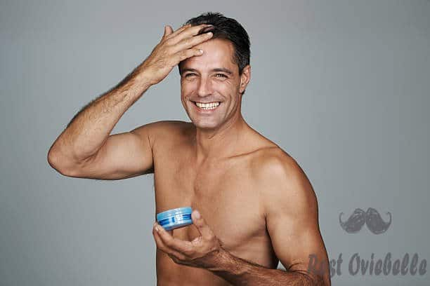 smiling while he's styling - hair gel for men stock pictures royalty-free photos & images best hair gel for men